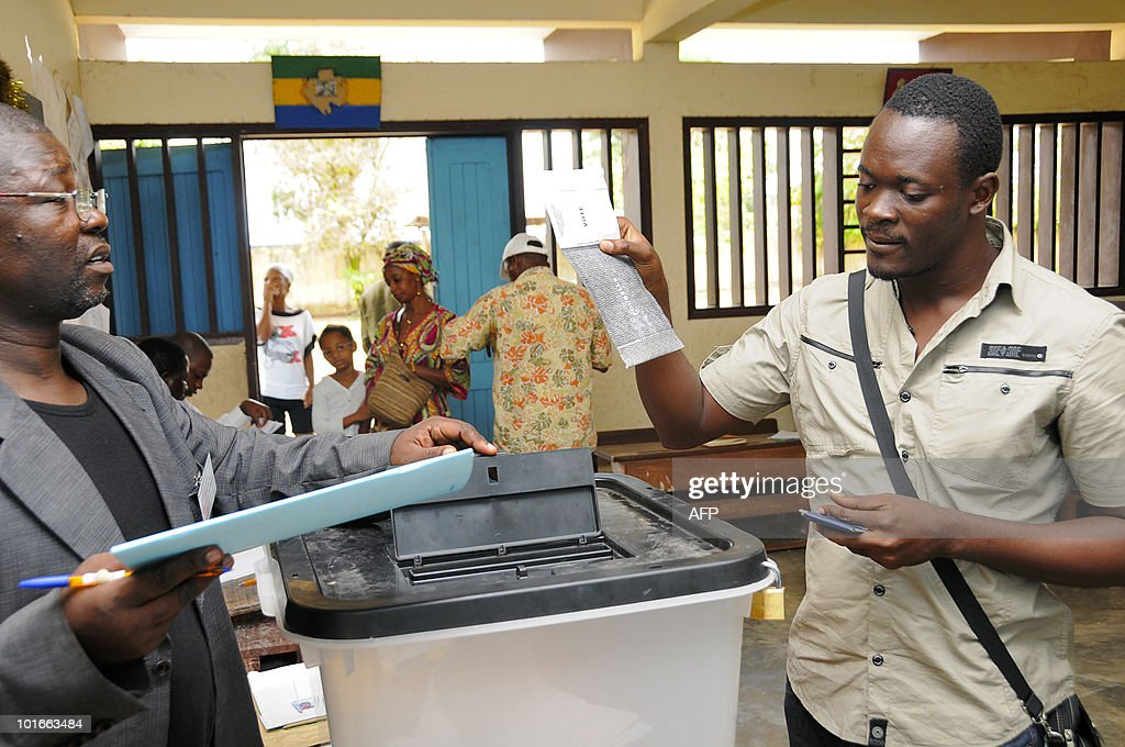 A Gabonese man casts his ballot as he votes for the partial elections on June 6, 2010 in a polling station of the 1st district of Libreville. Tight security forces were present during the whole day of elections in Libreville.