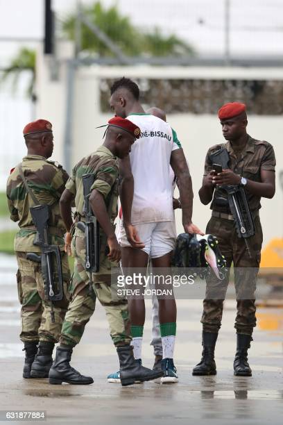 Gabonese military officers speak with players of Guinea Bissau during a training session in Libreville on January 17 2017 during the 2017 Africa Cup...