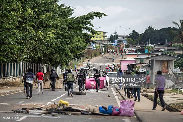 Gabonese police forces are seen clearing barricades in the streets adjacent to the National Assembly in Libreville on September 1 2016 The results of...