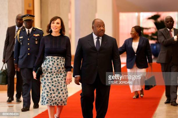Gabonese President Ali Bongo and his wife Sylvia arrive to the Presidential Palace on March 28 2017 in Libreville The inclusive political dialogue...