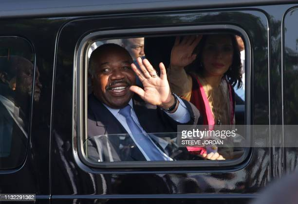 TOPSHOT Gabonese President Ali Bongo Ondimba waves from his car upon his arrival in Libreville on March 23 2019 Ali Bongo Ondimba in Morocco since...