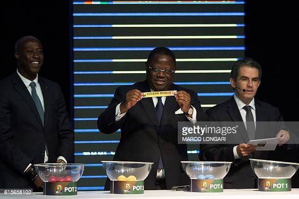 Gabonese Prime Minister FrancEmmanuel Issoze Ngonde shows a piece of paper bearing the name of Guinea Bissau as next to Confederation of African...