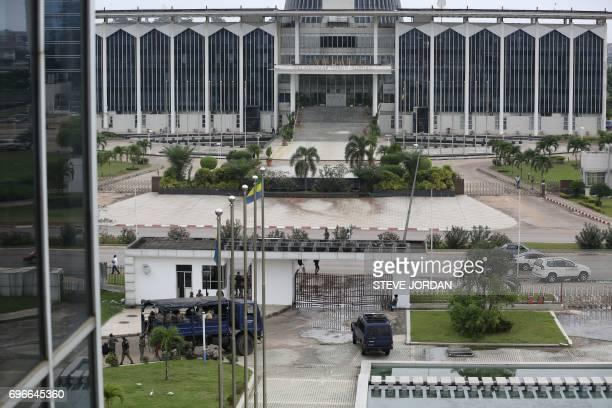 Gabonese security forces stand guard at the premises of the National Radio and Television centre in Libreville on June 16 after unknown assailants...
