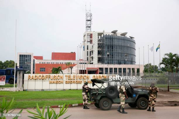 Gabonese soldiers stand in front of the headquarters of the national broadcaster Radiodiffusion Television Gabonaise in Libreville on January 7 2019...