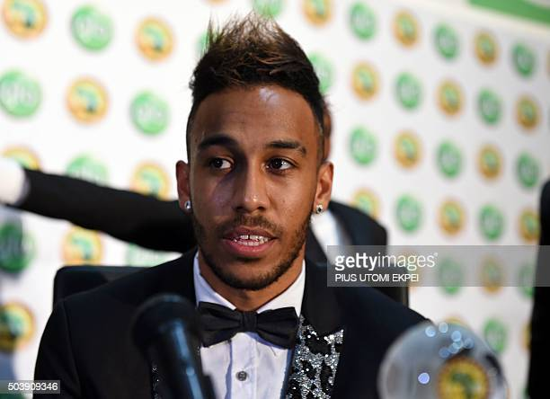 Gabonese striker PierreEmerick Aubameyang poses with the African Footballer of the Year Award during 2015 GloCAF Awards in Abuja on January 7 2016...