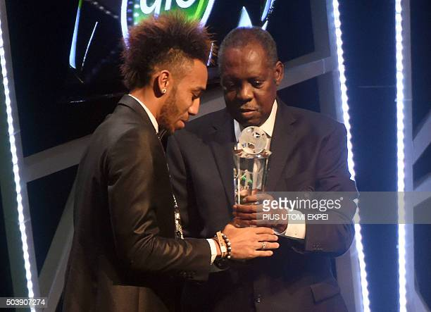 TOPSHOT Gabonese striker PierreEmerick Aubameyang receives African Footballer of the Year Award from President of African Football Confederation Issa...