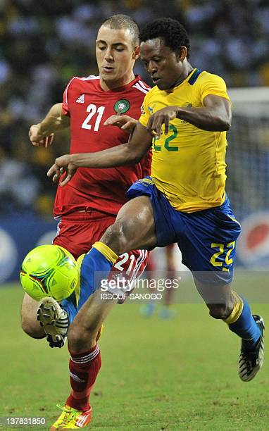 Gabon's Charly Moussono vies with Morocco's Amrabat Noureddine during their Africa Cup of Nations 2012 Group C football match between Gabon and...