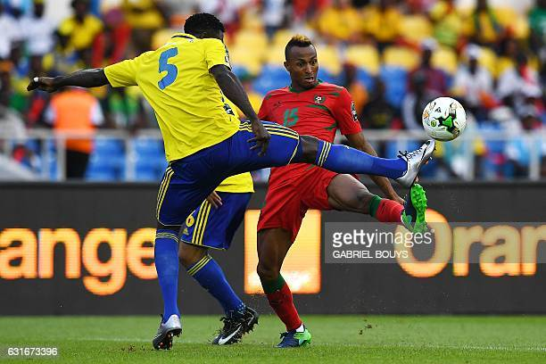 Gabon's defender Bruno Ecuele Manga challenges GuineaBissau's midfielder Toni Silva during the 2017 Africa Cup of Nations group A football match...