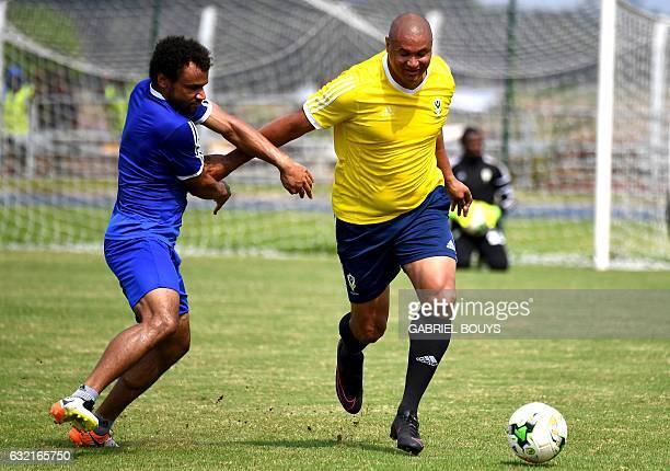 Gabon's defender Johann Obiang chases the ball with Gabon's general manager Daniel Cousin a training session of the Gabon national team in Libreville...