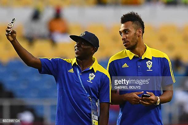 Gabon's forward PierreEmerick Aubameyang and Gabon's midfielder Merlin Tandjigora take a selfie ahead of the 2017 Africa Cup of Nations group A...