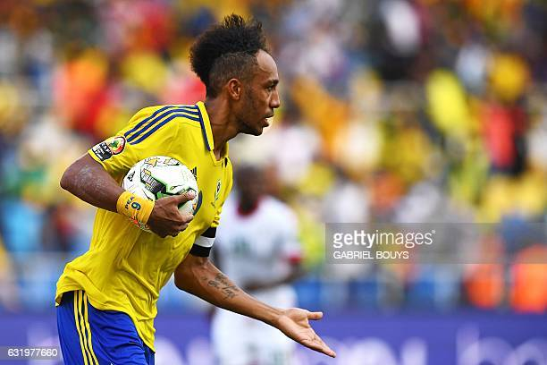 Gabon's forward PierreEmerick Aubameyang celebrates after scoring a penalty during the 2017 Africa Cup of Nations group A football match between...