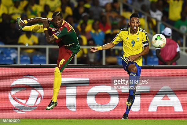 Gabon's forward PierreEmerick Aubameyang challenges Cameroon's defender Ambroise Oyongo during the 2017 Africa Cup of Nations group A football match...