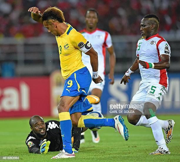 Gabon's forward PierreEmerick Aubameyang get past Burkina's goalkeeper Germain Sanou on his way to score a goal during the 2015 African Cup of...