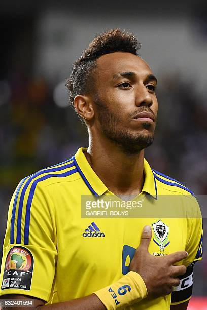 Gabon's forward PierreEmerick Aubameyang listens to the national anthems ahead of the 2017 Africa Cup of Nations group A football match between...