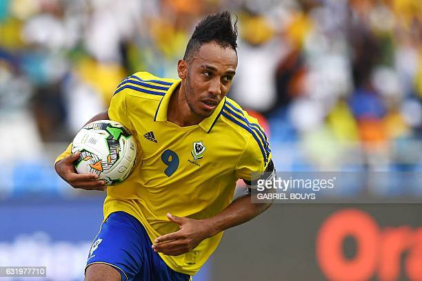 Gabon's forward PierreEmerick Aubameyang runs with the ball after scoring a penalty during the 2017 Africa Cup of Nations group A football match...