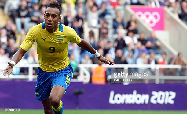 Gabon's Pierre Aubameyang celebrates after scoring during the 2012 Olympic mens football match between Gabon and Switzerland at St James' Park in...