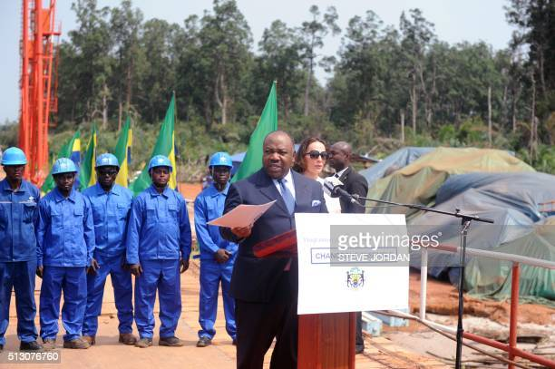 Gabon's President Ali Bongo Ondimba flanked by his wife Sylvia Bongo Ondimba announces on February 29 2016 in PortGentil that he will be part of the...