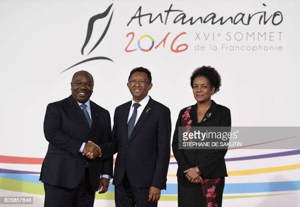 Gabon's President Ali Bongo Ondimba shakes hands with Madagascar's president Hery Rajaonarimampianina flanked by Secretary General of the...