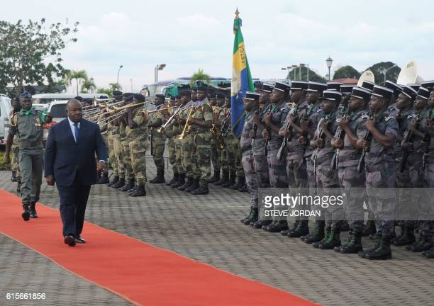 Gabon's President Ali Bongo reviews a military honour guard upon arrival for the 2017 African Cup of Nations draw ceremony on October 19 2016 in...
