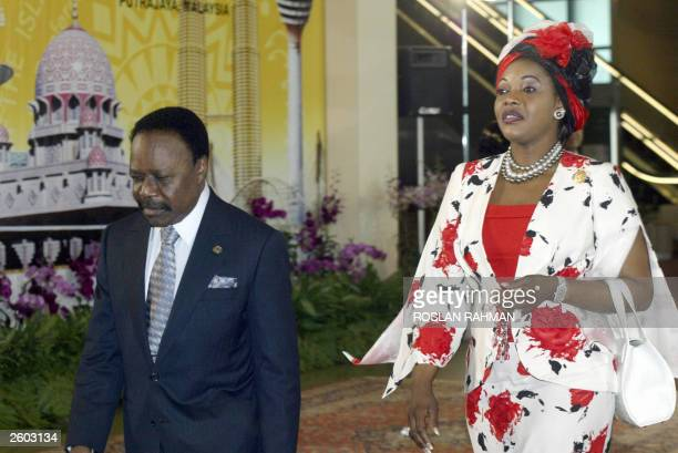 Gabon's President Omar Bongo and his wife, Lucie, arrive at the convention center for the opening of the 10th summit of the Organization of the...