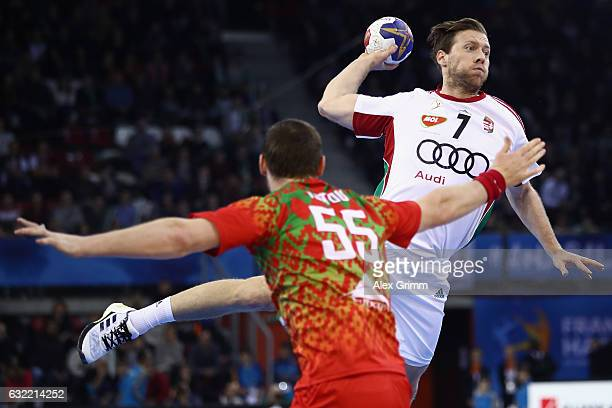 Gabor Csaszar of Hungary is challenged by Aliaksandr Tsitou of Belarus during the 25th IHF Men's World Championship 2017 match between Belarus and...