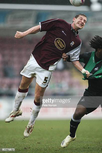 Gabor Gyepes of Northampton Town and Jason Scotland of Swansea City in action during the Coca Cola League One Match between Northampton Town and...