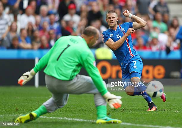 Gabor Kiraly of Hungary makes a save from Johann Gudmundsson of Iceland during the UEFA EURO 2016 Group F match between Iceland and Hungary at Stade...