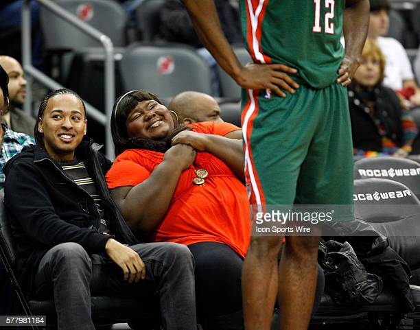 Gabourey Sidibe smiles as the New Jersey Nets play Milwaukee Bucks at the Prudential Center in January 8, 2011 in Newark, NJ.