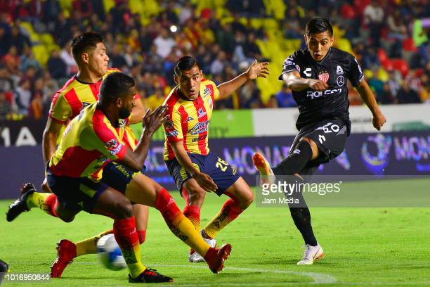 Gabriel Achilier Jorge Valadez Aldo Rocha of Morelia fight for the ball with Dieter Villalpando of Necaxa during the fourth round match between...