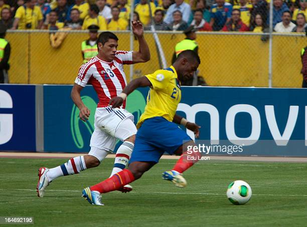 Gabriel Achilier of Ecuador fights for the ball with Richar Ortiz of Paraguay during a match between Ecuador and Paraguay as part of the 12th round...