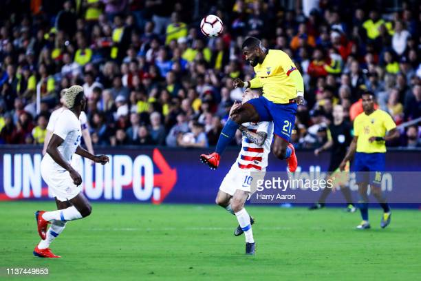 Gabriel Achilier of Ecuador jumps for a header against Christian Pulisic of United States in the half first at Orlando City Stadium on March 21 2019...