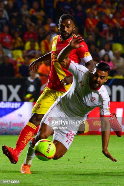 Gabriel Achilier of Morelia and Pedro Canelo of Toluca fight for the ball during the 15th round match between Morelia and Toluca as part of the...