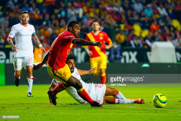 Gabriel Achilier of Morelia and Pedro Canelo of Toluca fight for the ball during the quarter finals first leg match between Morelia and Toluca as...