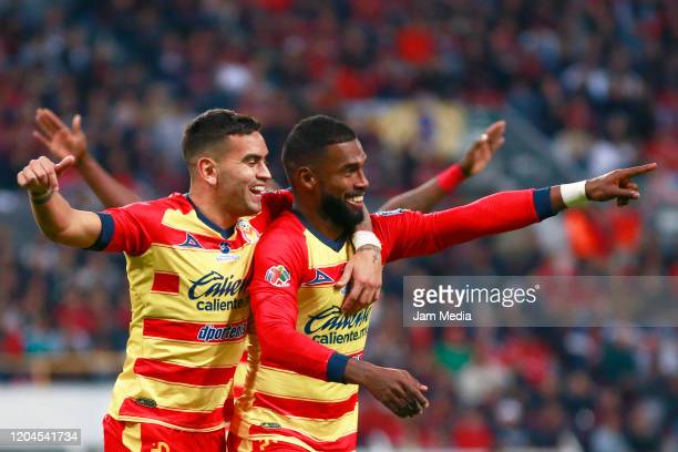 Gabriel Achilier of Morelia celebrates with teammates after scoring the second goal of his team during the 5th round match between Atlas and Morelia...