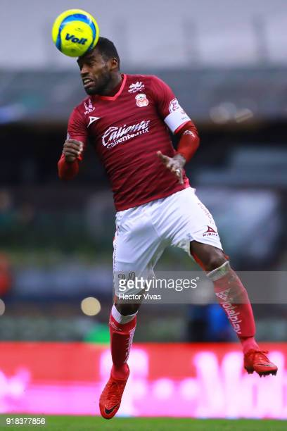 Gabriel Achilier of Morelia heads the ball during the 7th round match between America and Monarcas as part of the Torneo Clausura 2018 Liga MX at...