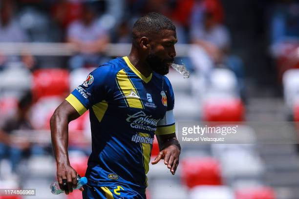Gabriel Achilier of Morelia spits water during the 9th round match between Toluca and Morelia as part of the Torneo Apertura 2019 Liga MX at Nemesio...