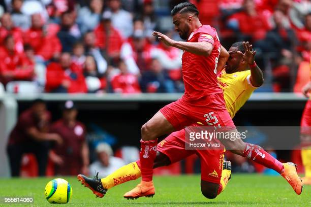 Gabriel Achilier of Morelia struggles for the ball with Pedro Canelo of Toluca during the quarter finals second leg match between Toluca and Morelia...