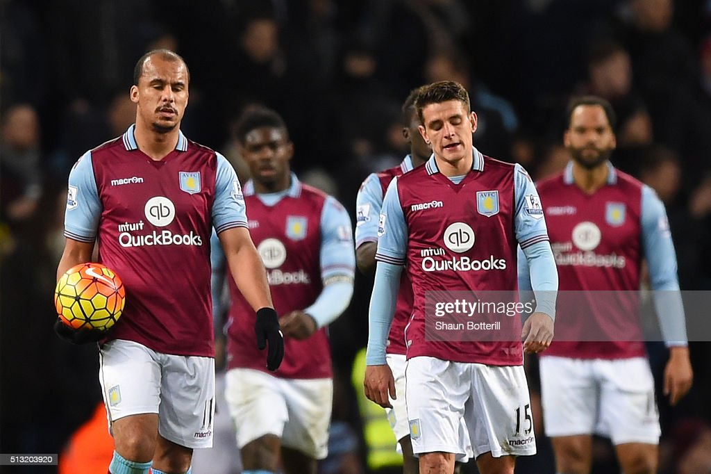 Gabriel Agbonlahor and Ashley Westwood of Aston Villa show their frustration after Everton's third goal during the Barclays Premier League match between Aston Villa and Everton at Villa Park on March 1, 2016 in Birmingham, England.