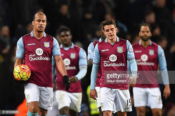 Gabriel Agbonlahor and Ashley Westwood of Aston Villa show their frustration after Everton's third goal during the Barclays Premier League match...