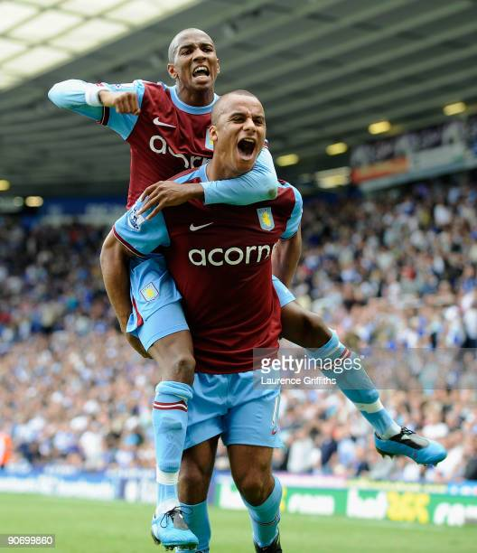 Gabriel Agbonlahor and Ashley Young of Aston Villa celebratevictory on the final whistle during the Barclays Premier League match between Birmingham...