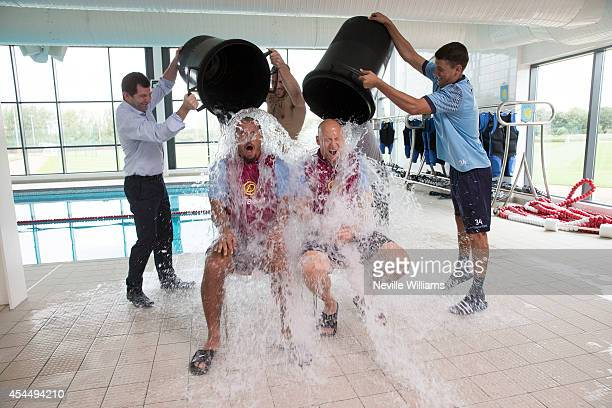 Gabriel Agbonlahor and Brad Guzan of Aston Villa take part in the Ice Bucket Challenge at the club's training ground at Bodymoor Heath on September...