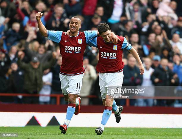 Gabriel Agbonlahor and Gareth Barry of Villa celebrate Barry's second goal and the teams third during the Premier League match between Aston Villa...