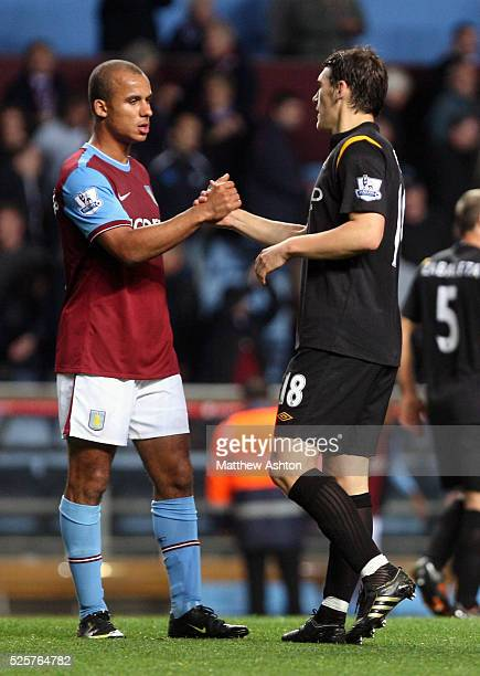 Gabriel Agbonlahor of Aston Villa and Gareth Barry of Manchester City shake hands at the end of the match