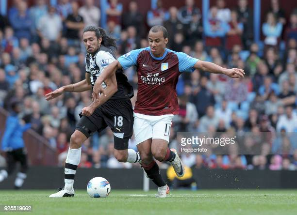 Gabriel Agbonlahor of Aston Villa and Jonas Gutierrez of Newcastle United in action during the Barclays Premier League match between Aston Villa and...