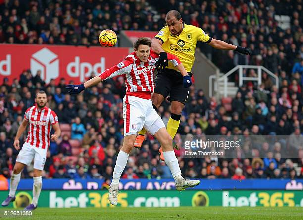 Gabriel Agbonlahor of Aston Villa and Philipp Wollscheid of Stoke City compete for the ball during the Barclays Premier League match between Stoke...