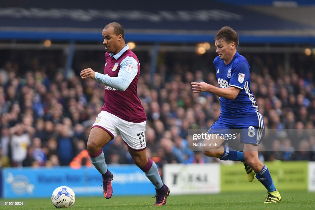 Gabriel Agbonlahor of Aston Villa and Stephen Gleeson of Birmingham City in action during the Sky Bet Championship match between Birmingham City and Aston Villa at St Andrews Stadium on October 30, 2016 in Birmingham, England.