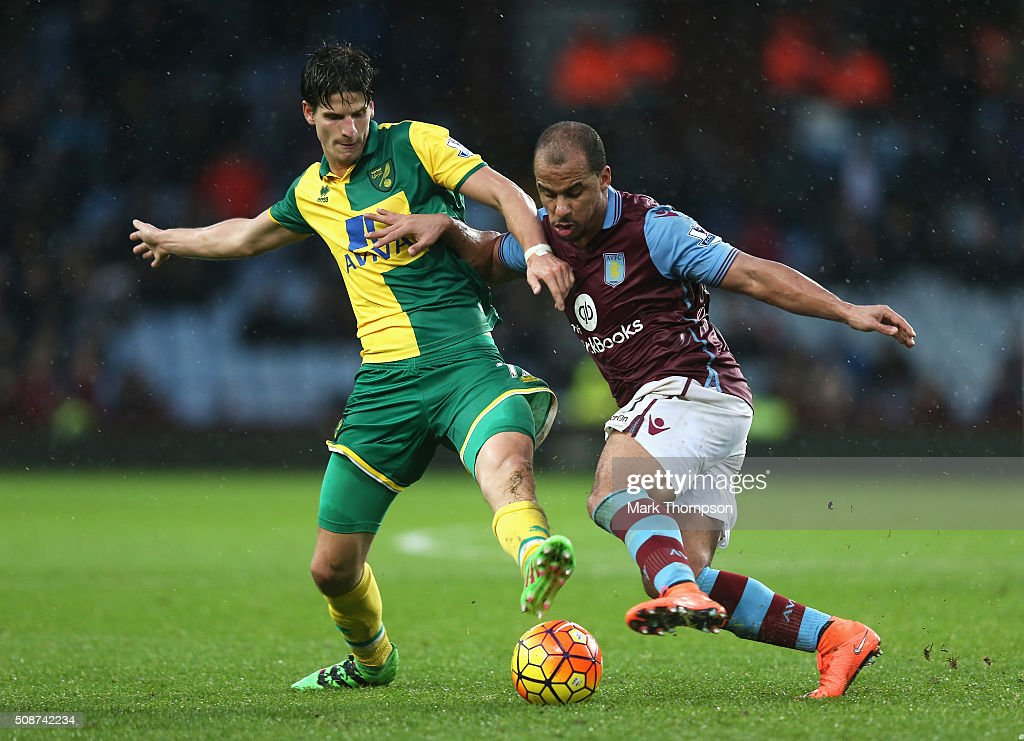 Gabriel Agbonlahor of Aston Villa and Timm Klose of Norwich City compete for the ball during the Barclays Premier League match between Aston Villa and Norwich City at Villa Park on February 6, 2016 in Birmingham, England.
