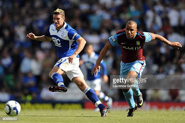 Gabriel Agbonlahor of Aston Villa battles for the ball with Franck Queudrue of Birmingham City during the Barclays Premier League match between...