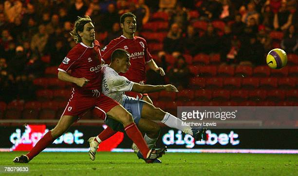 Gabriel Agbonlahor of Aston Villa beats Jonathan Woodgate of Middlesbrough to score his team's third goal during the Barclays Premier League match...