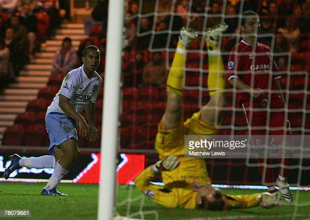 Gabriel Agbonlahor of Aston Villa beats Mark Schwarzer of Middlesbrough to score his teams third goal during the Barclays Premier League match...